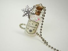"Glass Bottle Necklace | Small (2ml) glass vial filled with ""snow"" with aged/antiqued label and ..."