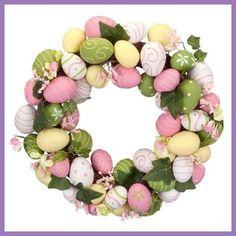 Love the spring colors featured in this Easter Egg Wreath.  Image from www.squidoo.com/easter-egg-wreath.