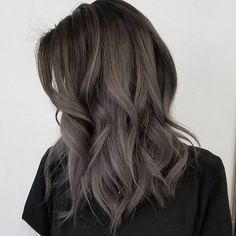 Dark grey ombré hair color, medium wavy hairstyle