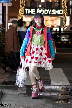 Cute and colorful Giovanni on the street in Harajuku, wearing 6%DOKIDOKI accessories, Super Lovers heart print skirt and Dance With Devils anime goods.