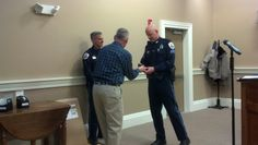 SRO Murray receives his watch dedicating his 25 years of service