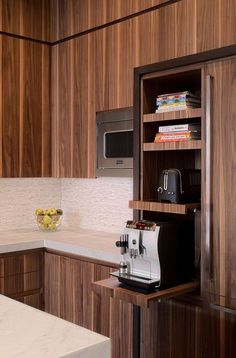 Kitchen Design Idea - Pull-Out Counters (10 Pictures) // Pull-out counters don't just have to go underneath the counter. Put them up higher to make sliding shelves that free up your countertops and keep your appliances easily accessible. http://amzn.to/2keVOw4