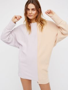 Coloring In Pullover | This super comfy and oversized pullover looks like 2 sweatshirts were pieced together. Features a raw, uneven hem for a worn-in feel…you'll never want to take this off.