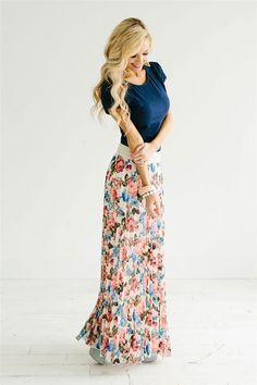Not only is this maxi skirt beautiful, it is comfortable too! Features a pretty elastic waist following by a pleated blue, moss and coral floral print skirt. Fully lined.