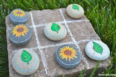 Garden Tic-Tac-Toe with painted rocks.