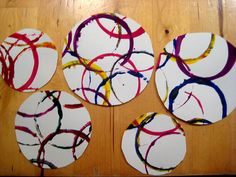 Open-ended process art: printing with kids: messy play, circles, bright colour, transformed into a wreath