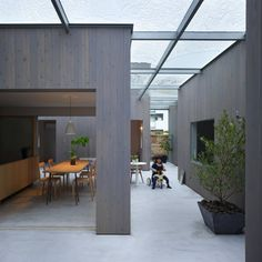 Quite an interesting idea (from Japan, where else), the house as a number of separate single-room structures inside a glazed over courtyard -- House in Buzen, Japan, by Suppose Design Office Wood Interior Design, Patio Interior, Design Interiors, Modern Japanese Architecture, Interior Architecture, Architecture Panel, Drawing Architecture, Architecture Portfolio, Roof Design