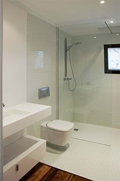 wall hung pan next to glass shower screen