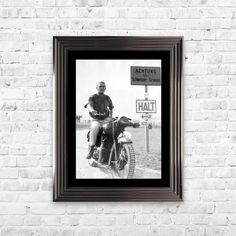 Steve McQueen Framed Posters The King of Cool at his finest hour in The Great Escape Image. The gunmetal edged frame is the perfect finishing touch to the black and white print of the Bullit film star.