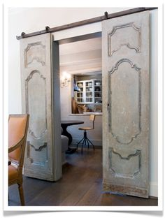 Once again....is it a trend? Love the barn style hang of the door with the pretty doors! Cool closet doors too.