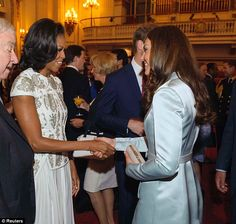 THESE TWO TOGETHER!!!! Catching up: First Lady Michelle Obama greets Kate during a reception at Buckingham Palace earlier today