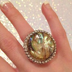 Statement opal like ring I love its brilliance! All the little stones that surround it. This is a great bold cocktail ring for whatever the occasion fits a ring size 5 comfortably Jewelry Rings