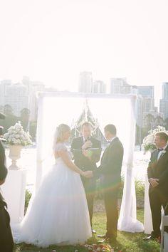 Elegant wedding arch   Pedestal and urn flowers   White wedding   Brisbane River   Kangaroo Point   Riverlife