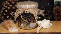 The glass jar is filled with:  One naturally mummified mourning dove foot Two snail shells Muss Mourning dove small bones One pine cone  Due the glass reflection, pictures can't show how pretty it is. This glass jar has been filled with collected species that I have found in nature.   N...
