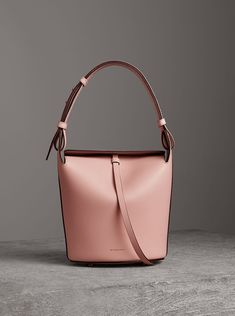 610748fd228e A block-colour bucket bag by  Burberry in pale ash rose. The sleek