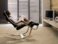 Office Workspace. Brown Beige Cozy Reclining Office Chair Lay Down In Smooth White Fur Rug