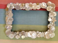 BUTTON- ANTIQUE MOTHER OF PEARLAntique mother of pearl (MOP) custom picture  frame.  A bride requested that I make set of 5 of these frames to be given to her bridesmaids as thank you gifts.  Of course, while they were all the same size, each one was unique & one of a kind.  It was a challenge finding that many MOP buttons that were the right size & yet represented an interesting variety of shapes.  Icing on the cake - I found a few new sources of buttons through the process.