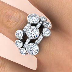 Diamond scatter ring with nine brilliant cut diamonds and pave set diamonds in the bands.