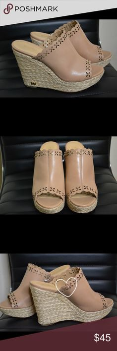 Michael Kors tan leather wedge sandals Michael Kors tan leather wedge sandals | Worn once | Flaw as shown in 3rd photo | Size 8 KORS Michael Kors Shoes Wedges