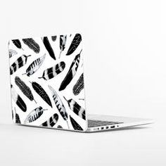 Laptop Skins from WallsNeedLove | lifestyle @wallsneedlove tribal feather design. Black and white #decor #wallsneedlove #interiordesign #tribal #bohemian #blackandwhite #tech #laptop