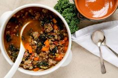 Delicious tuscan kale soup with spicy sausage and tons of flavor. Make it for a friend. They'll thank you for it! Gluten Free, Paleo, Low Carb and Delicious