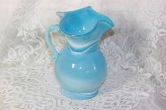 Vintage Blue & White Slag Glass Pitcher. Starting at $25