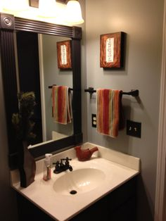 Here's another cheap bathroom remodel...easy and cheap!  (P.S...we made this mirror for about seven dollars...take a peak at the clearance molding and use your existing mirror to fit.  We found a video that helped us cut the mirror down to size.)  Good Luck!