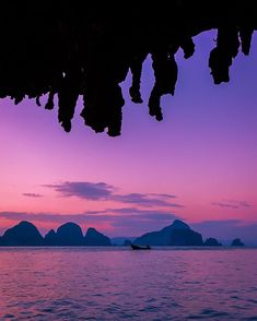 Sunset from the Sea Caves of Krabi in Thailand. .................. After an amazing day of exploring sea caves we made our way back to our camp for the evening. As the sun set we set up our tents and we walked down to another cave. After exploring for a bit I turned around and saw this scene unfolding at the mouth of the cave. To me it really captures just some of the beauty that Thailand has to offer. .................... Sea kayaking is the best way to explore Krabi. You can get into…