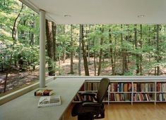 Now, this is my kind a library! The Scholar's Library in Olive Bridge, New York by local architecture firm Gluck & Partners is an unusual raised house plan surrounded by lush, leafy woods.