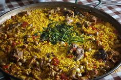 Murcian Rice (Arroz Murciana)  Similar to Paella.Ingredients; rice, chicken, rabbit, snails,tomato,parsley.   www.thespanishthymetraveller.com