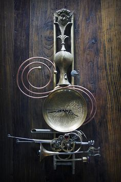 Created from an old trombone slide and a few odds and ends from around the studio, this hanging clock assemblage is a great example of just what can be created with re-purposed brass and copper pie