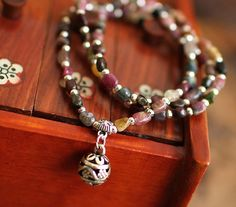 Check out this item in my Etsy shop https://www.etsy.com/listing/188839377/natural-tourmaline-stone-mala-bracelet