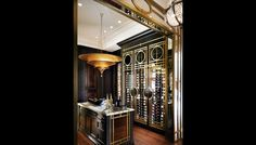 """Glamour continues in the wine room, which was designed to be practical for entertaining at home. """"It makes sense to have the wine cellar upstairs as the nucleus of the space, rather than having to go downstairs to get a bottle of wine,"""" says Morris. This """"cellar"""" (there is another cellar downstairs) is easily accessible from the kitchen and dining and family rooms. It accommodates more than 600 bottles, which are handsomely housed within glass-fronted cabinets adorned with more fretwork…"""