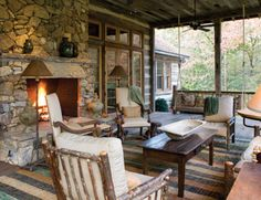 stone fireplace, porch on back, wrap it around to side...make side dining/outdoor kitchen area.