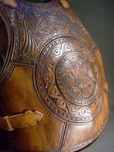 The phoenix bird leather armor by Zoltán Koszta, via Behance
