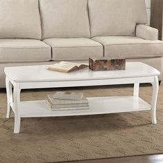 Rounded edges and slight saber legs offer understated embellishment to the design of the Alberts Coffee Table. Features a large lower shelf that can accommodate storage baskets or a display of books and photographs.