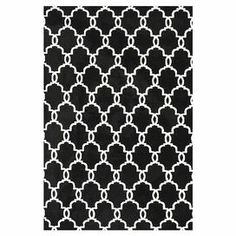 Add elegant appeal to your living room or den with this stylish rug, featuring a classic links motif in onyx.