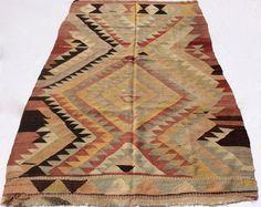 Hand woven Turkish Kilim rug with Earth tone colors, 7,5 x 4,6 feet