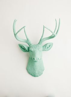 Faux Deer Head - The Eleanor - Seafoam Green Resin Deer Head- Deer Antlers Mounted- Faux Head Wall Mount. $109.99, via Etsy.