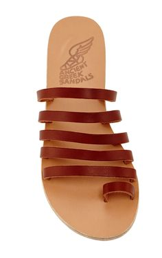 These Ancient Greek Sandals are rendered in brown vachetta leather and feature multiple straps. Now Available on Moda Operandi