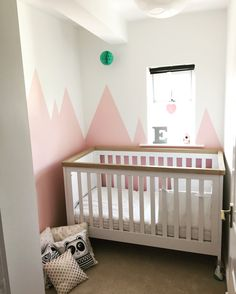 Elexis' nursery is finally finished. I love her pink mountain walls