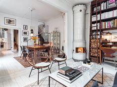 Genom mattor skapas olika rum i rummet (öppen planlösning) på ett väldigt snyggt sätt.