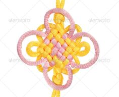 Macrame of yellow and purple lace. ...  Bonding, attached, background, bend, boat, cable, climbing, closeup, concept, connect, connection, cord, equipment, fasten, flower, guide, hold, isolated, joint, knot, lace, line, link, loop, macrame, macro, marina, port, protection, purple, rope, safety, sail, secure, security, ship, single, strength, string, strong, texture, thread, tie, tight, twine, twist, up, white, yacht, yellow