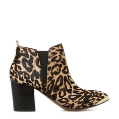 This in-demand bootie by REPORT SIGNATURE puts the rest to shame. Leopard-print calf hair and a metallic pointed-toe lend unique details that are still subtle enough to be dressed up or down accordingly.