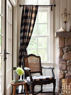 We couldn't talk about rustic window treatments without mentioning the ever-dependable plaid. Give plaid curtains a modern update in navy or black buffalo check that'll easily coordinate with other colors and withstand the test of time. Use them as rustic cabin curtains or bring country style to your everyday living room. For a true homey feel, use bits of the fabric elsewhere around the room. Try it on a throw pillow or upholstered cushion like the traditional cane back chair shown here. Rustic Curtains, Cabin Curtains, Bedroom Curtains, Farmhouse Style Curtains, Curtains Living, Modern Window Treatments, Farmhouse Window Treatments, Window Treatments Living Room Curtains, Buffalo Plaid Curtains
