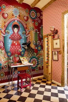 Fantastic wall mural, possibly Shepard Fairey wall paper adjacent wall.  Love the checkerboard floor.  Now this is an entry.
