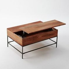 I have this coffee table and I lurve it. From West Elm.