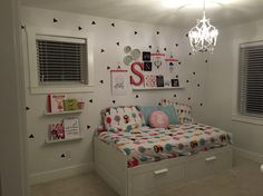 Kids Gallery wall with decals.   Hangers were 99 cent trouser hangers from ikea that were painted to match the red in the bedding.  Prints were designed in illustrator, black canvas prints were from Target. Picture ledges also from IKEA. S typography was 7.99 from Ross- also repainted to match with the hangers. Decals were handcut and repurposed from a large chalkboard decal bought online years ago.