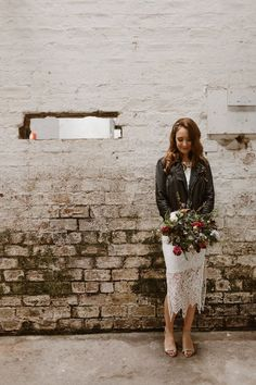 Katie wore a leather jacket for her cool, modern, warehouse wedding in Glasgow. Photography by The Curries.