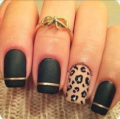 Jewels: ring knuckle black gold bow knuckle ring leopard print jewelry nails nail polish